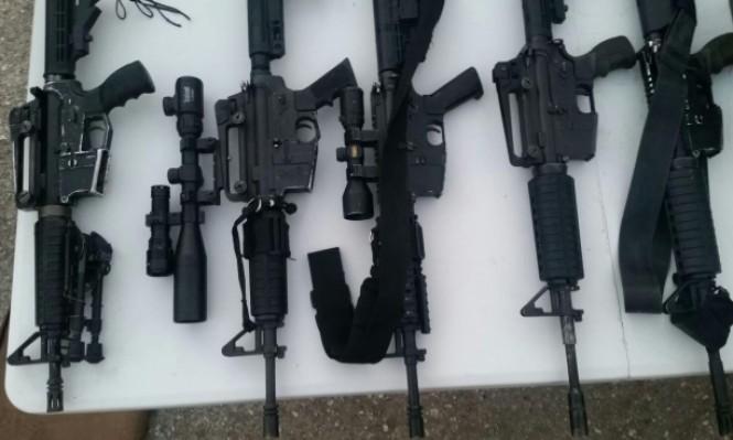 اعتقال 11 فلسطينيا ومصادرة اسلحة من الضفة